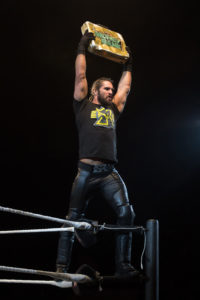 Seth_Rollins_holds_Money_in_the_Bank_briefcase_at_a_WWE_house_show_in_January_2015